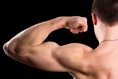 close-up of a man flexing his arm muscles