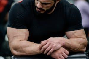 muscular man looking at his biceps