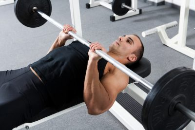 man performing a pressing exercise at the gym