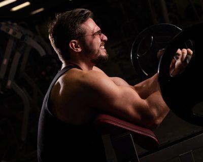 man training his biceps