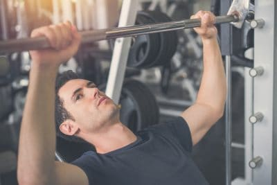man training his upper body inside the gym