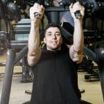 man training on a modern gym machine