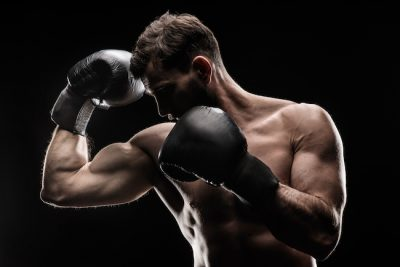 man wearing black boxing gloves