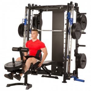 muscular man doing seated leg extensions
