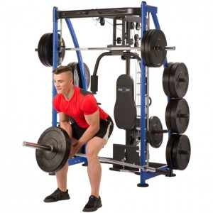 man smiling while performing t-bar rows