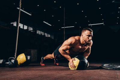 man performing a medicine ball push-up
