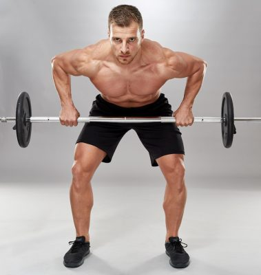 muscular man doing a barbell row