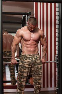 bodybuilder doing shrugs in the gym