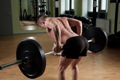 man doing underhand barbell rows