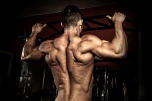 bodybuilder doing pull-ups