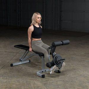 sporty woman doing leg extensions