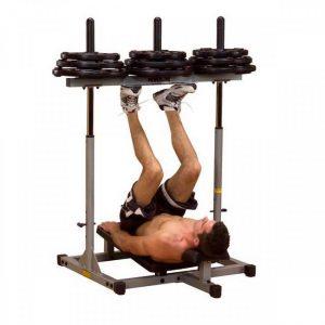sporty man performing a vertical leg press