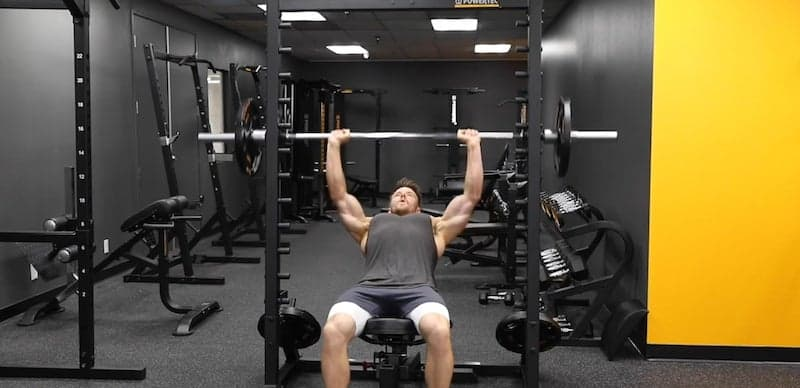 man working his chest with the incline bench press