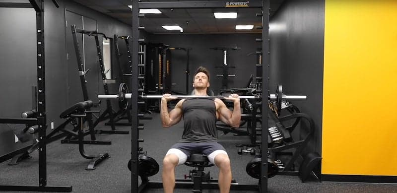man training his pecs with incline presses