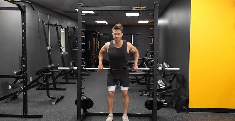 fitness model doing rows for his back