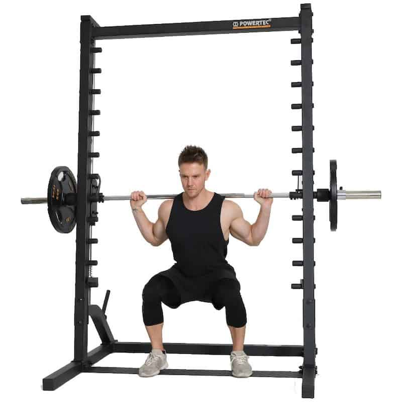 fitness model doing squats with good technique