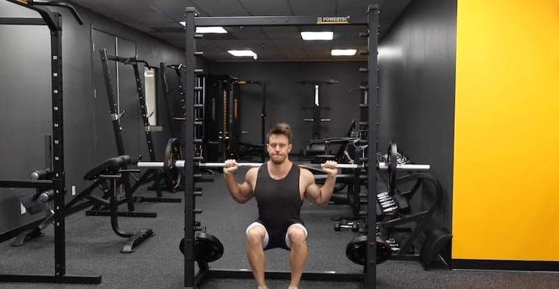 muscular man training his legs