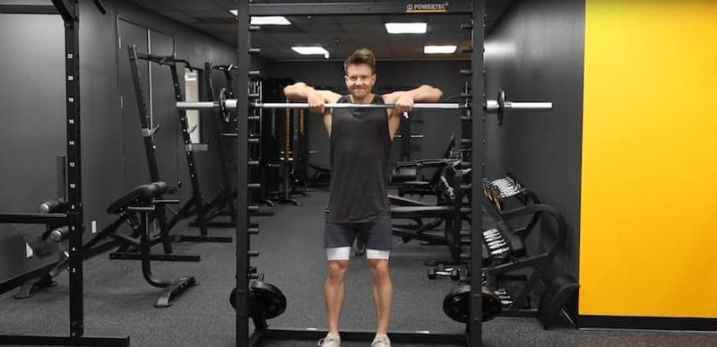 man performing heavy upright rows