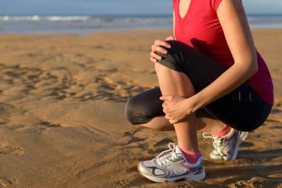 female runner with shin splints