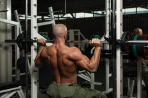 back-view of a bodybuilder training his shoulders