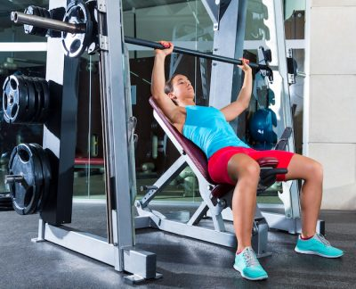 woman doing an incline press exercise