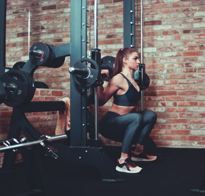 sporty woman doing back squats