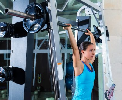 sporty woman training her shoulders