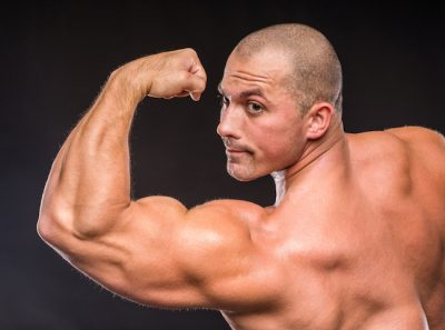 bodybuilder flexing his big biceps