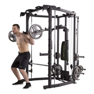 muscular man doing barbell squats
