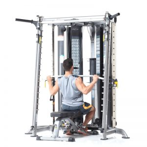 man in a vest doing lat pulldowns