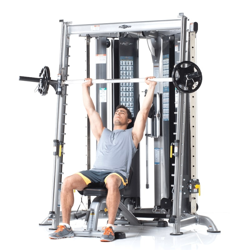 athletic man doing a shoulder press