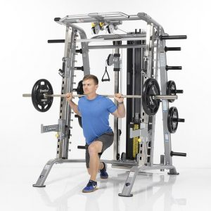 athletic man doing weighted lunges