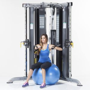 woman training her upper body while sat on an exercise ball