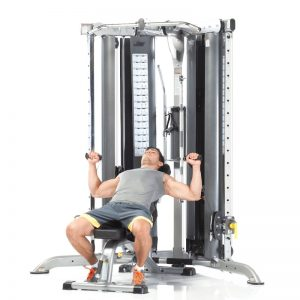 man doing incline bench presses with cables