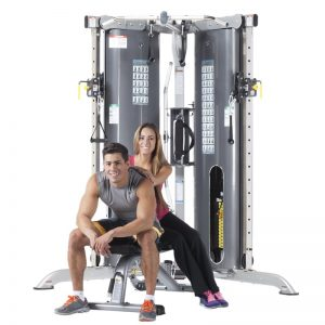man and a woman sitting in front of gym machine