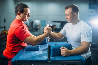 Two arm wrestlers prepares for the battle at the table