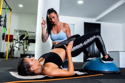 two girls training glutes