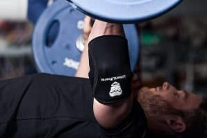 man working out with his urban lifter elbow sleeves