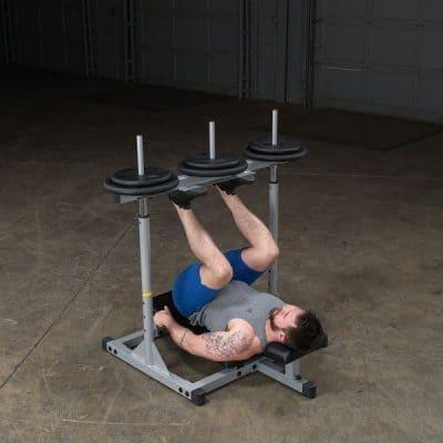 man performing a vertical leg press