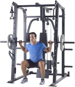 very muscular man doing back squats