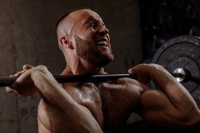 weightlifer struggling to lift a heavy barbell