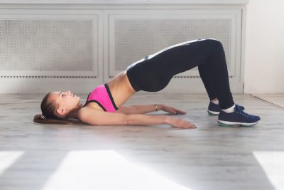 woman doing lower body exercise on the floor