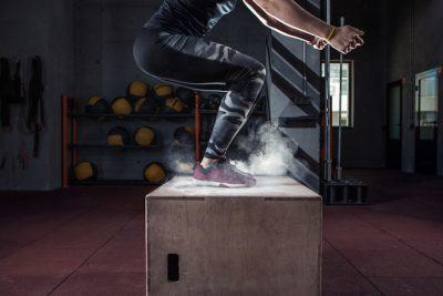 female athlete performing a box jump