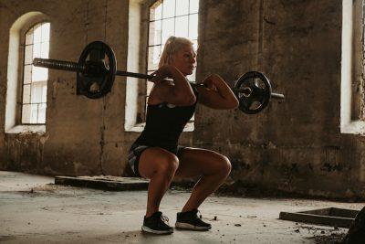 female doing leg exercises for a photo shoot