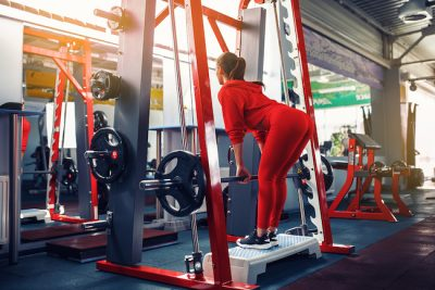 woman working out on a smith machine