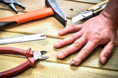 man with finger injury sustained from tools