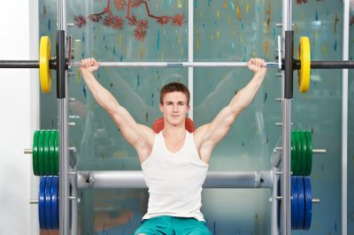 young man performing a shoulder press