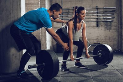 woman working out with her personal trainer