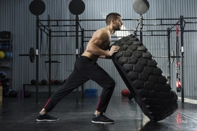 athlete flipping a tire