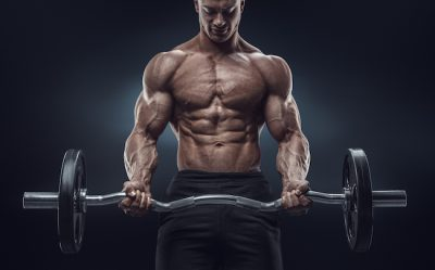 ripped fitness model doing bicep curls